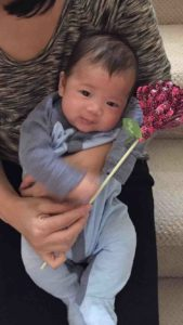 This cutie loves his Flirty Flower!